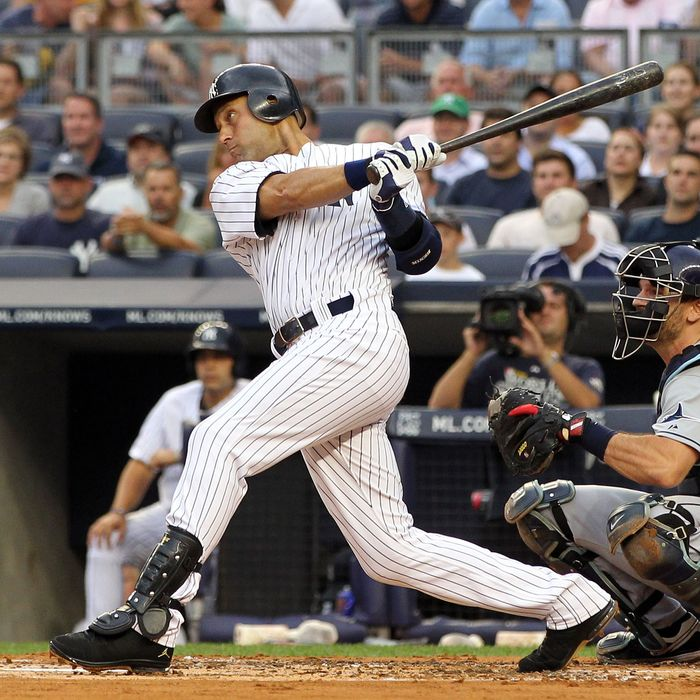 NEW YORK, NY - JULY 07: Derek Jeter #2 of the New York Yankees hits a double in the first inning for career hit 2998 while playing against the Tampa Bay Rays at Yankee Stadium on July 7, 2011 in the Bronx borough of New York City. (Photo by Michael Heiman/Getty Images)