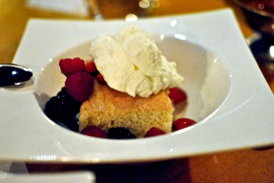 With berries, with the feel of a slightly denser take on tres leches.