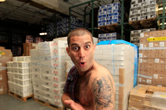 Adam Moskowitz, President of Larkin Inc., shows his cow tattoo in front to boxes cheeses on Wednesday, June 23, 2010. Adam will be hosting Cheesemonger Invitational Competition inside his building located at 47-55 27th Avenue in Long Island City, Queens.