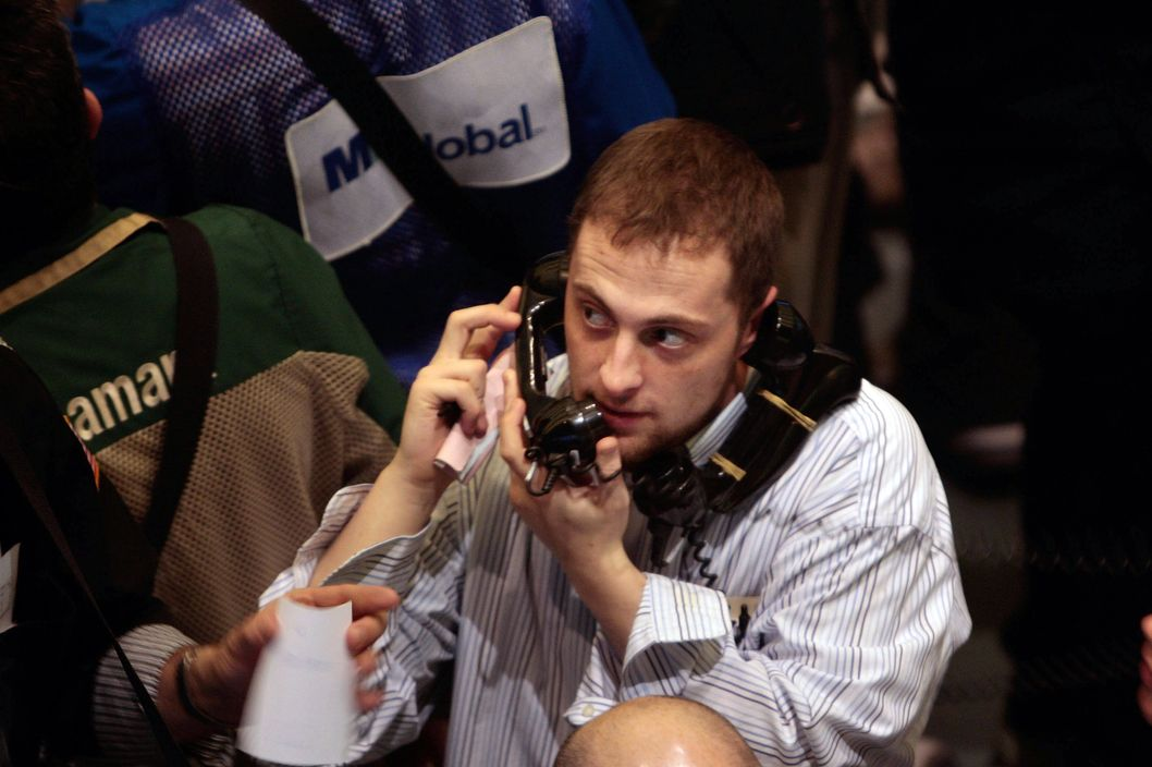 A trader holds two phones to his ears during activity in the crude oil options area on the floor of the New York Mercantile Exchange March 6, 2008 in New York City.  Oil prices rose to a record of nearly $106 a barrel before steadying by mid-day.