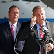 Maine Gov. Paul LePage, right, speaks to reporters while visiting C&L Aviation with New Jersey Gov. Chris Christie, Tuesday, Aug. 12, 2014, in Bangor, Maine.  Christie returned to Maine to campaign for LePage's re-election campaign. (AP Photo/Robert F. Bukaty)