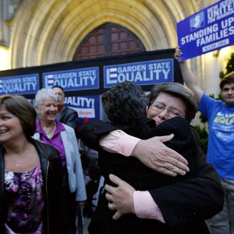 Cindy Meneghin, second from right, hugs her attorney Hayley Gorenberg during a rally at Garden State Equality in Montclair, N.J., hours after a Superior Court Judge ruled that New Jersey is unconstitutionally denying federal benefits to gay couples and must allow them to marry Friday, Sept. 27, 2013. Meneghin has been with her partner, Maureen Kilian, left, for 39 years. Judge Mary Jacobson ruled it legal for gay couples to marry in the state beginning Oct. 21, 2013. The ruling comes after a group of gay marriage supporters sued the state in July, days after the U.S. Supreme Court struck down key parts of a law that blocked the federal government from granting benefits to gay couples.