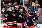 New York Rangers Marian Gaborik (10), Brad Richards (19), Brian Boyle (22) and Mats Zuccarello (36) celebrate Richard's goal against New York Islanders