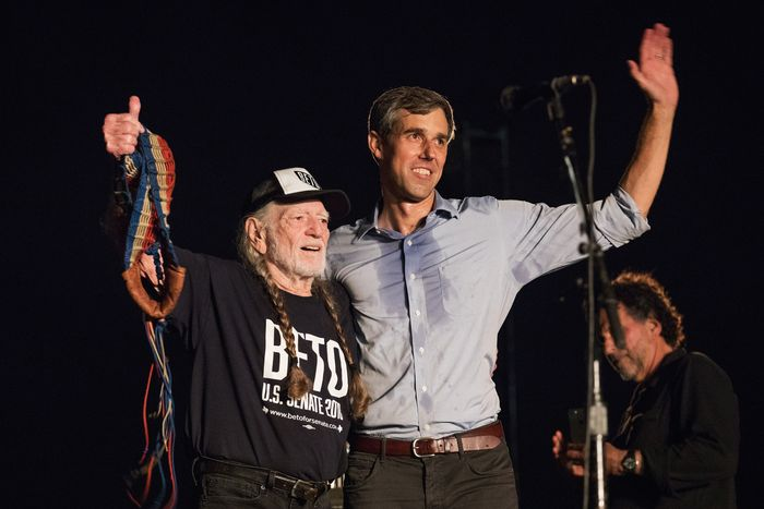 O'Rourke sweats alongside Willie Nelson, who does not appear to be sweating.