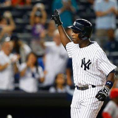 Alfonso Soriano #12 of the New York Yankees celebrates his seventh inning three-run home run against the Los Angeles Angels of Anaheim at Yankee Stadium on August 13, 2013  in the Bronx borough of New York City.