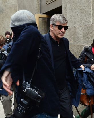 Actor Alec Baldwin (C) leaves Manhattan Criminal Court through a crowd of media after testifying against accused stalker Canadian actress Genevieve Sabourin November 12, 2013 in New York. AFP PHOTO/Stan HONDA (Photo credit should read STAN HONDA/AFP/Getty Images)
