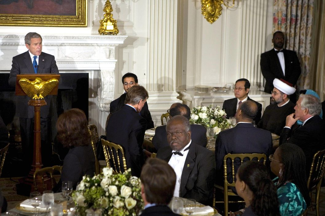 US President George W. Bush speaks during an iftar dinner in the State Dining Room at the White House 16 October 2006 in Washington. The White House hosted its 6th iftar, the meal which breaks Muslims' daytime fasting during the holy month of Ramadan.