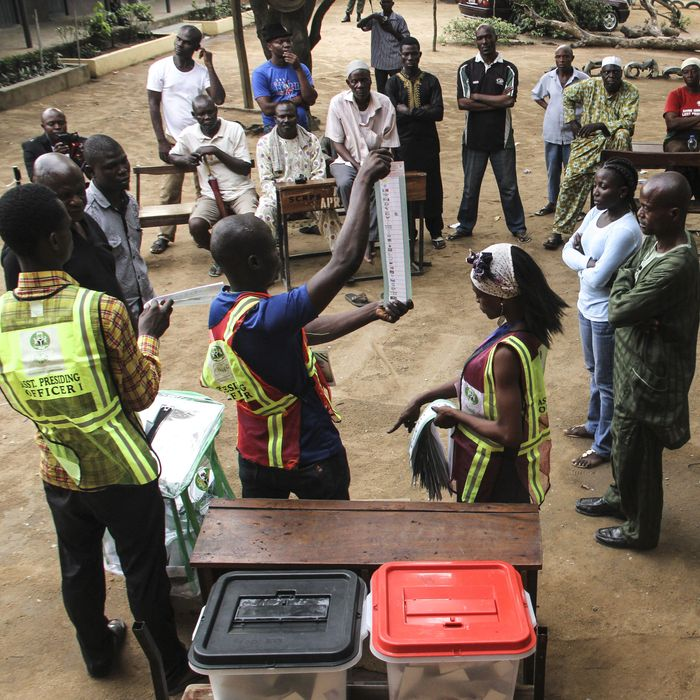 Electoral officials in Lagos count ballots in Nigeria's 2015 presidential election.