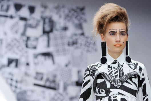 LONDON, UNITED KINGDOM - SEPTEMBER 17: A model showcases designs on the catwalk by Louise Gray on day 4 of London Fashion Week Spring/Summer 2013, at The Topshop Venue on September 17, 2012 in London, England. (Photo by Stuart Wilson/Getty Images)