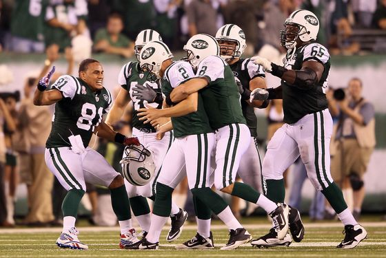 EAST RUTHERFORD, NJ - SEPTEMBER 11:  Nick Folk #2 of the New York Jets celebrates with teammates Dustin Keller #81, Mark Brunell #8 and Brandon Moore #65 of the New York Jets after FOlk kicked a successful 50-yard game-winning field goal against the Dallas Cowboys during their NFL Season Opening Game at MetLife Stadium on September 11, 2011 in East Rutherford, New Jersey.  (Photo by Elsa/Getty Images)