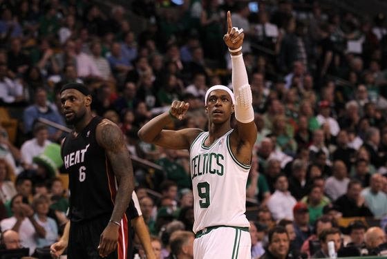 Rajon Rondo #9 of the Boston Celtics gestures on court as LeBron James #6 of the Miami Heat looks on in Game Four of the Eastern Conference Finals in the 2012 NBA Playoffs on June 3, 2012 at TD Garden in Boston, Massachusetts.