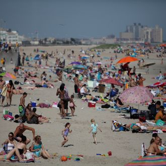 The crowds tend to gather near 92nd St. at Rockaway Beach like this day on Sunday, June 20, 2011.
