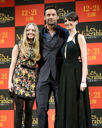 US actress Amanda Seyfreid (L), Australian actor Hugh Jackman (C) and US actress Anne Hathaway (R) pose for photographers during an event to promote their latest movie 'Les Miserables' in Tokyo on November 28, 2012. The film will be shown all over Japan from December 21.