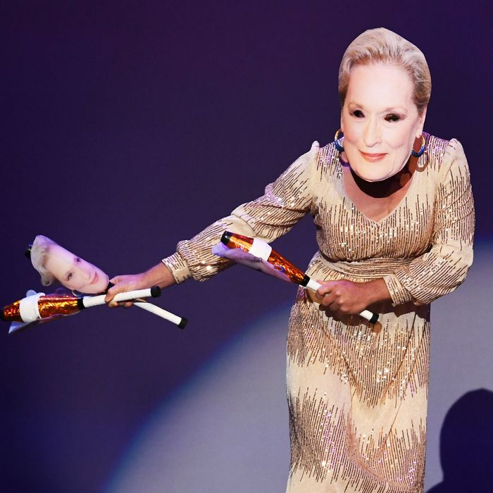 A dancer in a Meryl Streep mask performs during the Emmys. Why? Who knows.