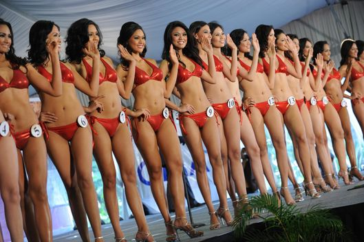 Twenty four Filipina beauty contestants for the Binibining Pilipinas 2008 (Miss Philippines) beauty pageant pose in their bikinis during a presentation to the press at a hotel in Manila on February 21, 2008.  The cadidates, who are 17 to 25 years of age, students and professionals, will be vying for the prestigious crown on March 8, 2008. The three winners will represent the country in the Miss International, Miss Universe and Miss World.