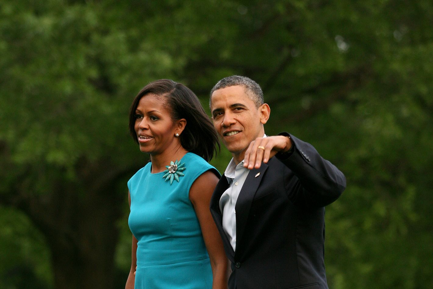 U.S. President Barack Obama and first lady Michelle Obama return to the South Lawn of the White House following a day trip to Ohio and Virginia on May 5, 2012 in Washington, DC. President Obama officially kicked off his 2012 campaign for reelection today.