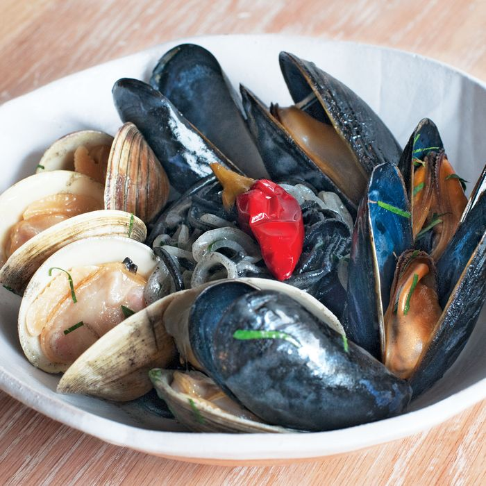 Squid-ink chitarra with clams, mussels, and Calabrian chile.