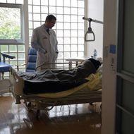 Doctor Stephane Mercier, Head of the palliative care unit, visits a patient at the palliative care unit of the AP-HP Paul-Brousse Hospital in Villejuif near Paris March 4, 2015.