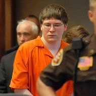 "FILE - In this Aug. 2, 2007 file photo, Brendan Dassey is escorted into court for his sentencing in Manitowoc, Wis. The Netflix documentary series ""Making a Murderer"" tells the story of a Wisconsin man wrongly convicted of sexual assault only to be accused, along with his nephew, of killing a photographer two years after being released. Steven Avery and his then 17-year-old nephew Dassey were accused of killing Teresa Halbach, a photographer who visited the Avery family salvage yard to take photos of a minivan on Halloween and was never seen alive again. (Herald Times Reporter/Eric Young via AP, Pool)"