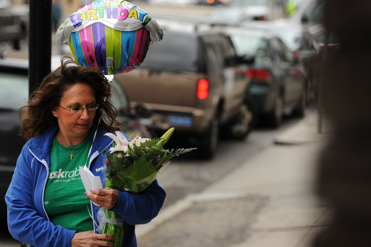 Diane Hohen, with TaskRabbit, delivers a bouquet of flowers in Boston on March 29, 2012. TaskRabbit is a task and errand service that allows people to hire others to do small jobs.
