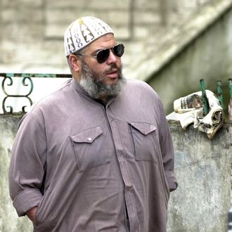 Imam Abu Hamza al-Masri arrives at Finsbury Park mosque in central London 11 September 2002 to address a controversial day-long rally. The leading British radical Muslim told a local daily that the September 11 attacks were an FBI conspiracy that triggered a global war between Islam and Christianity and will end with Muslim hegemony.