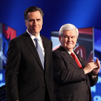 CHARLESTON, SC - JANUARY 19: Republican presidential candidates (L-R) former Speaker of the House Newt Gingrich, and former Massachusetts Gov. Mitt Romney arrive on stage before a debate at the North Charleston Coliseum January 19, 2012 in Charleston, South Carolina. The debate, hosted by CNN and the Southern Republican Leadership Conference, is the final debate before South Carolina voters head to the polls for their primary January 21. (Photo by Win McNamee/Getty Images)