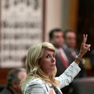 State Sen. Wendy Davis (D-Ft. Worth) holds up two fingers against the anti-abortion bill SB5, which was up for a vote on the last day of the legislative special session June 25, 2013 in Austin, Texas. A combination of Sen. Davis' 13-hour filibuster and protests by reproductive rights advocates helped to ultimately defeat the controversial abortion legislation at midnight.