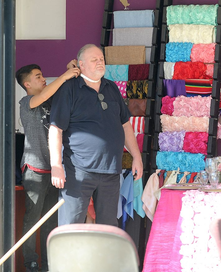 Thomas Markle getting measured for a suit.