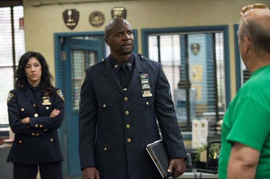 "BROOKLYN NINE-NINE: (L-R) Rosa (Stephanie Beatriz), Sgt. Jeffords (Terry Crews) in the ""The Funeral"" episode of BROOKLYN NINE-NINE airing Sunday, Oct. 4 (8:30-9:00 PM ET/PT) on FOX. ©2015 Fox Broadcasting Co. CR: Eddy Chen/FOX."