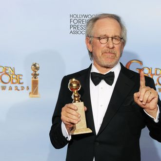 BEVERLY HILLS, CA - JANUARY 15: Director/producer Steven Spielberg poses in the press room with the Best Animated Film award for