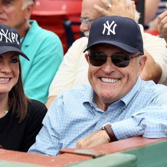 Former New York City Mayor Rudy Giuliani and his wife Judith attend the Boston Red Sox v New York Yankees game on August 6, 2011 at Fenway Park in Boston, Massachusetts.