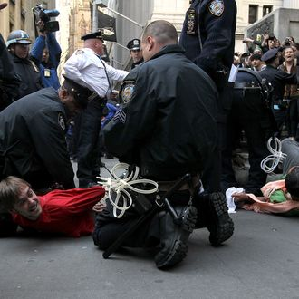 NEW YORK, NY - APRIL 13: Occupy Wall Street protestors are arrested by New York City police officers during a demonstration across the street from the New York Stock Exchange on April 13, 2012 in New York City. In preparation for massive May Day demonstrations, Occupy Wall Street protestors continue to hold weekly