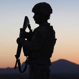 U.S. Army National Guardsman Spc. Bernard Mendoza, 24, watches for illegal immigrants and drug smugglers crossing the U.S.-Mexico border on June 22, 2011 in Nogales, Arizona.