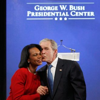 Former U.S. President George W. Bush kisses Former Secretary of State Condolezza Rice