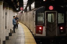 NEW YORK, NY - AUGUST 29:  Commuters wait for the subway August 29, 2011 in New York City. One day after Hurricane Irene hit New York the mass transit system, including subways and buses, began moving again in a limited capacity in time for Monday's rush hour.  (Photo by Joe Raedle/Getty Images)