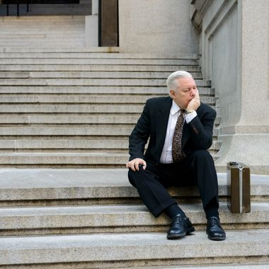 Manhattan, New York City, New York State, USA --- Sad businessman on steps --- Image by ? Image Source/Corbis