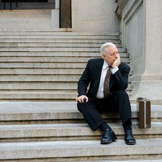 Manhattan, New York City, New York State, USA --- Sad businessman on steps --- Image by ? Image Source/Corbis