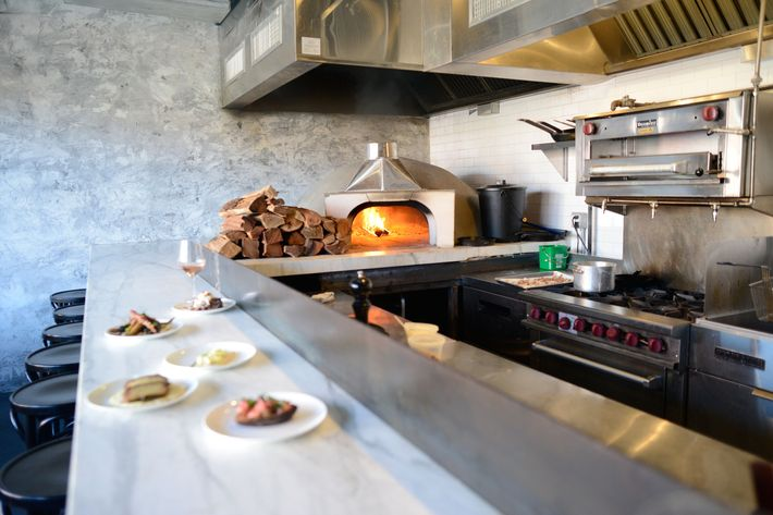 The wood-burning oven and kitchen counter.