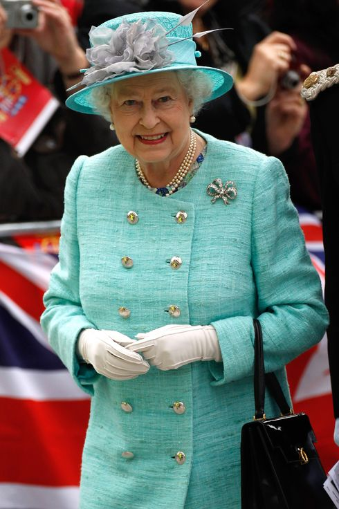 Queen Elizabeth II arrives at Nottingham Town Hall during her visit to the East Midlands on June 13, 2012 in Nottingham, England. The Queen was accompanied by Prince William, Duke of Cambridge and Catherine, Duchess of Cambridge, during her official visit to the East Midlands. Prince William will later make his official tribute to the Queen for the Jubilee.