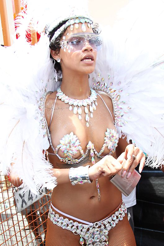 Rihanna is pictured partying in the street with Zulu International