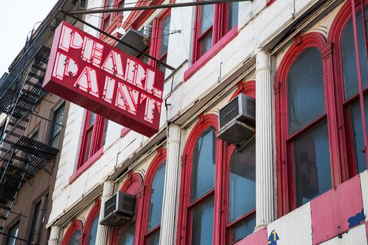 a sign hangs outside Pearl Paint, a famed art supply and paint store, on Canal Street on April 10, 2014 in New York City. The Building Pearl Paint occupies has reportedly been put up for sale, prompting rumors that the New York City arts supply institution may close.