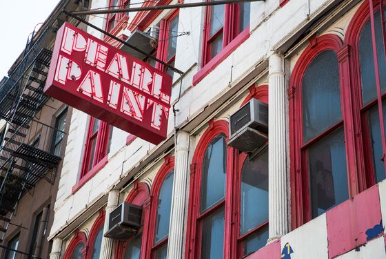a sign hangs outside Pearl Paint, a famed art supply and paint store, on Canal Street on April 10, 2014 in New York City. The Building Pearl Paint occupies has