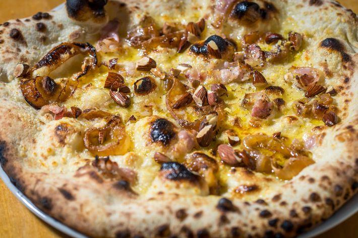 Peasant's Delight: wood-roasted onions, smoked bacon, lemon zest, almonds, fennel pollen, Grana Padano.