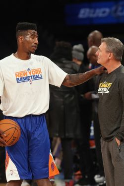Head Coach Mike D'Antoni of the Los Angeles Lakers (formerly of the Knicks) speaks with Iman Shumpert #21 of the New York Knicks prior to the game at Madison Square Garden on December 13, 2012 in New York City.