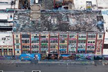 http://5ptz.com/graff/                        5Pointz Aerosol Art Center, Inc. is an outdoor art exhibit space in Long Island City, New York, considered to be the world'??s premiere '??graffiti Mecca,'?? where aerosol artists from around the globe paint colorful pieces on the walls of a 200,000-square-foot factory building. The name 5Pointz signifies the five boroughs coming together as one but, because of its reputation as an epicenter of the graffiti scene, the industrial complex has actually united aerosol artists from across the world. Legendary writers from Canada, Switzerland, the Netherlands, Japan, Brazil, and all over the United States have painted on the building walls, including Stay High 149, Tracy 168, Cope2, Part, and Tats Cru. Over the past decade, the striking, graffiti-covered warehouse has attracted several hip-hop and R&B stars, including Doug E. Fresh, Kurtis Blow, Grandmaster Kaz, Mobb Deep, Rahzel, DJ JS-1, Boot Camp Clik, Joan Jett, and Joss Stone. On any given day, 5Pointz visitors can expect to find prominent artists, musicians, deejays, Emcees (rappers), and B-boys (break dancers) on site, in addition to filmmakers, photographers, and entire tour buses full of admirers soaking in the more than 350 Technicolor murals. The gallery curator is graffiti veteran Jonathan Cohen, best known by his signature tag, '??Meres One.'?? His goal is to convert the five-story, block-long industrial complex at Jackson Avenue and Davis Street, formerly the Phun Phactory, into a graffiti art museum. Mission Statement 5Pointz gallery curator, Meres, plans to convert the five-story, block-long industrial complex at Jackson Avenue and Davis Street into a graffiti museum. He is currently seeking a 501(c)3 certification for 5Pointz to confer tax-exempt status and allow tax-deductible donations. In addition, he plans to open a school for aspiring aerosol artists, complete with a formalized curriculum that imparts lessons in teamwork, art history, and entrepreneurship