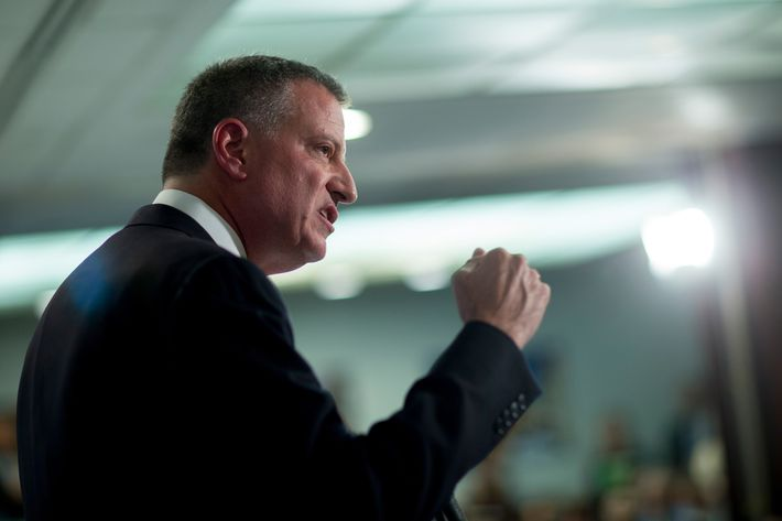 "Bill de Blasio, mayor of New York, speaks during a Roosevelt Institute event at the National Press Club in Washington, D.C., U.S., on Tuesday, May 12, 2015. Joseph Stiglitz, the Nobel Prize-winning economist who popularized the term ""the 1 percent"" to spotlight increasing income inequality, headlined the first stop of a four-day U.S. tour by de Blasio. Stiglitz presented the study ""Rewriting the Rules for the American Economy: an Agenda for Shared Prosperity"" at the event. Photographer: Andrew Harrer/Bloomberg via Getty Images"