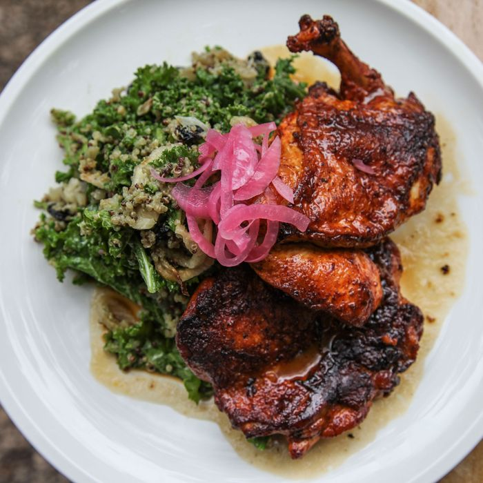 Achiote-roasted chicken with kale, quinoa, feta cheese, shitake mushrooms, and dried blueberries.