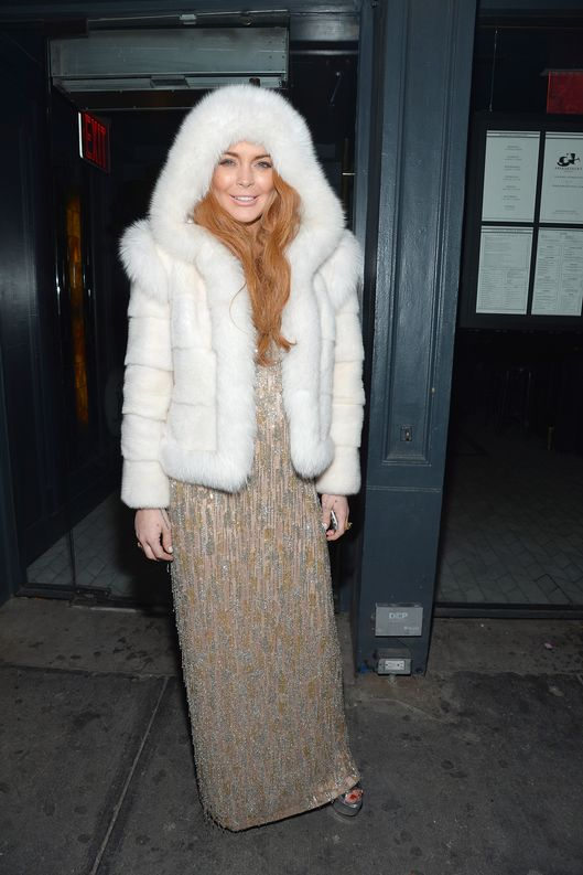 NEW YORK, NY - FEBRUARY 06:  Actress Lindsay Lohan poses outside of the amfAR Gala after party in celebration of Mercedes-Benz Fashion Week at SL on February 6, 2013 in New York City.  (Photo by Mike Coppola/Getty Images for Mercedes-Benz Fashion Week)