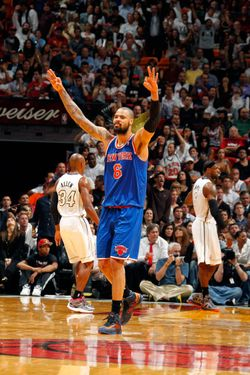 Tyson Chandler #6 of the New York Knicks puts his hand up after a three point shot agains the Miami Heat during a game on December 6, 2012 at American Airlines Arena in Miami, Florida.