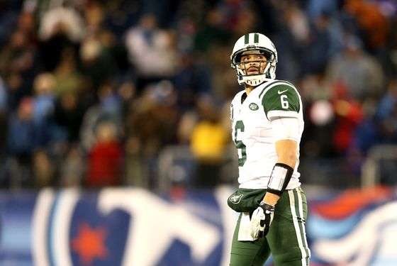 Quarterback Mark Sanchez #6 of the New York Jets walks off the field after a play in the fourth quarter against the Tennessee Titans at LP Field on December 17, 2012 in Nashville, Tennessee.